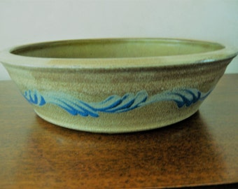 Blue swirls on bronze pie plate