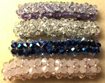 "Beautiful and eyecatching, Swarovski Crystals adorn this 2 1/4"" French Barrette"