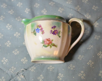 A Vintage China Pitcher with Flowers That is Marked Germany