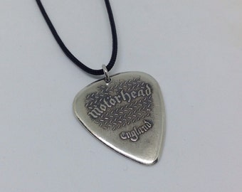 Handmade silver guitar pick