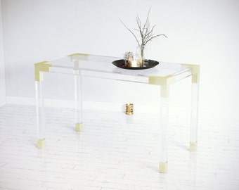 built2order lucite desk with brass accents