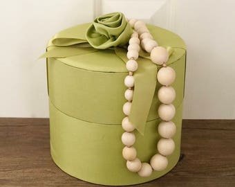 vintage hat-box style box padded satin apple green