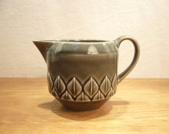 Vintage 1970s Holkham Pottery milk jug with relief moulded leaf border pattern under a grey glaze
