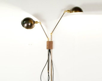 brass and walnut adjustable twoarm plug in or wired sconce and wall lamp