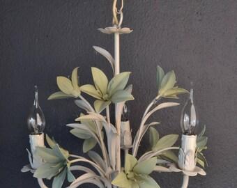 Tole flower chandelier with green flowers