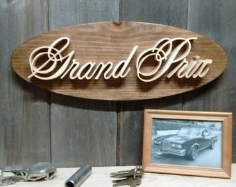 1978 Pontiac Grand Prix Emblem Oval Wall Plaque-Unique scroll saw automotive art created from wood for your garage, shop or man cave.