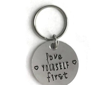 Love yourself first key chain