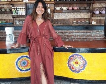 Boho long sleeved and hooded maxi dress. Boho style comes in three colors.