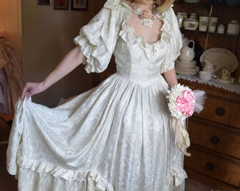 Amazing Vintage Wedding Gown Ivory Satin Damask Bountiful Full Flowing Fabric Bows Ruffles and a Plunging Neckline Size 6-8