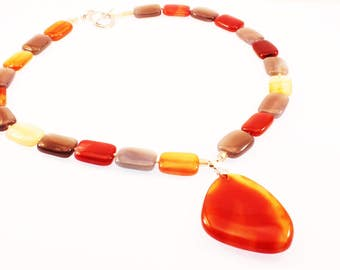 18 Inch Woman's Necklace with Burnt Orange Pendant and beads of gray, brown, yellow, orange glass.