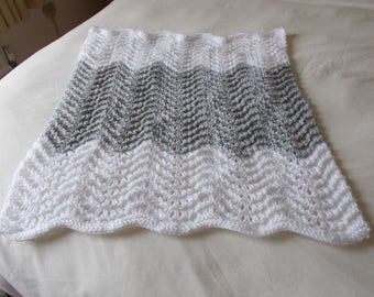 Hand knitted silver/grey and white crib/pram blanket
