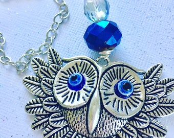 """Tibetan silver owl pendant with glass eyes wire wrapped on 30"""" nickel free chain. Crystal accents."""