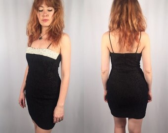 Vintage black stretch lace and pearl dress