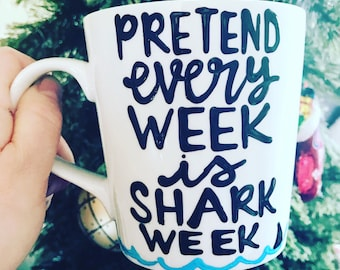 Pretend every week is shark week. Shark week. I love shark week. Coffee mug.