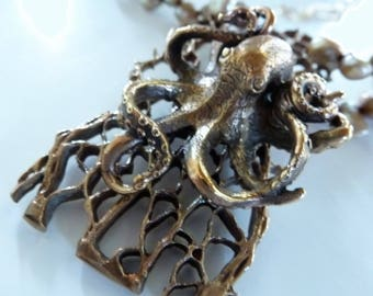 Coral Kraken Necklace is a Bob Burkett bronze octopus I mounted on this hunky bronze coral piece on doubled bronze pearls and gold chain.