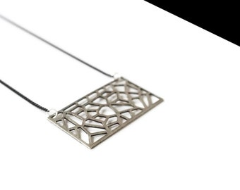 Perforated plate necklace silver.