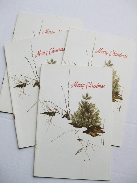 """Four """"Merry Christmas / Christmas Traditions"""" booklets from Economics Press. 1974. Christmas tree Santa Claus. Wassail bowl. Hostess gift."""