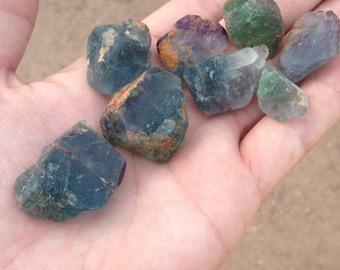 8 stones of blue green fluorite