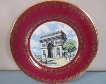 French Limoges porcelain plate, Heavy gilding with central hand painted 'Arc de Triomph' in the centre, very stylish. collectable plate
