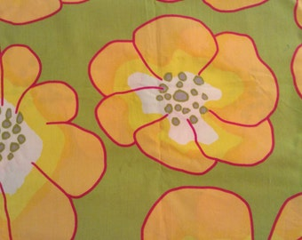 Large yellow floral with green background, a hint of pink, cotton