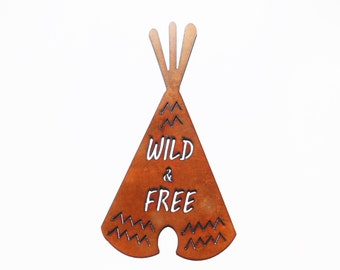 "Teepee image sign that reads ""Wild and free"" made out of rusted rusty rustic metal"