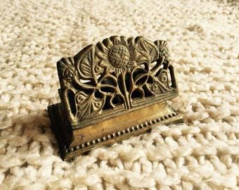 Vintage brass sunflower stamp roll holder