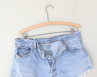 vintage 1980's distressed cut off levis 501 button fly  jean shorts 35