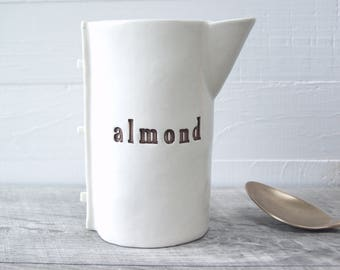 Almond Milk Creamer.  Hand-Built Fired Ceramic Creamer For Almond Milk.  With Brown Letters.