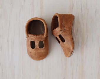 t-straps / soft soled shoes / baby moccasins moccs/ loafers / distressed caramel