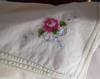 Dinner napkins set of four linen with counted cross stitch roses on the courner.