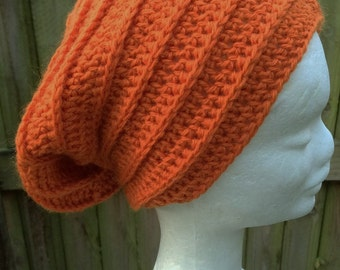 Crocheted textured slouchy beanie in orange pure Australian wool