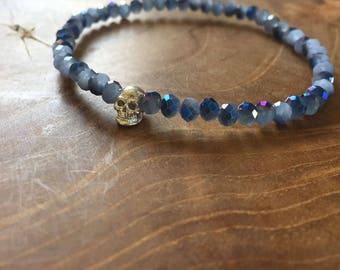 Blue faceted Skull: elastic beaded bracelet with silver skull and blue glass beads. metallic, facet, silvertone, skull, rock, edgy