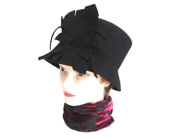 Black wool felt cloche hat with large decorative floral trim in the front, narrow brim, elegant, classy, Kasmo Design, Australia