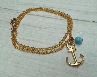 Anker Anchor vergoldetes Armkettchen Armband mit blauer Glasperle