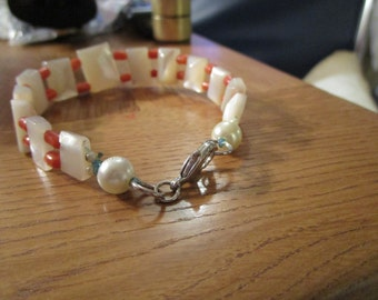 """vintage bracelet mother of pearl squares/orange beads/silvertone clasp with faux pearls  good condition 7.5""""long"""