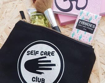 Self Care Club or Mother, Defender, Woman, Strength screen printed make up essentials pouch in black and white