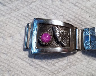 sterling silver watchband tips with wolf and 8 mm Ruby star sapphires.  very good sapphires.