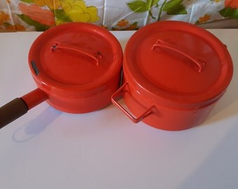 Two red enamel pots with lids