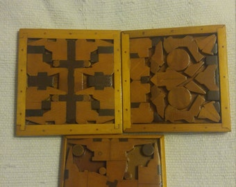 Three wooden puzzle pictures