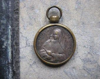 a vintage french religious medal, vintage relic, saint emilie de rodat