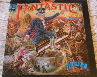 "Elton John - Captain Fantastic And The Brown Dirt Cowboy. Vintage Vinyl 12"" Gatefold Album. With Original Lyrics And Scraps Booklets."