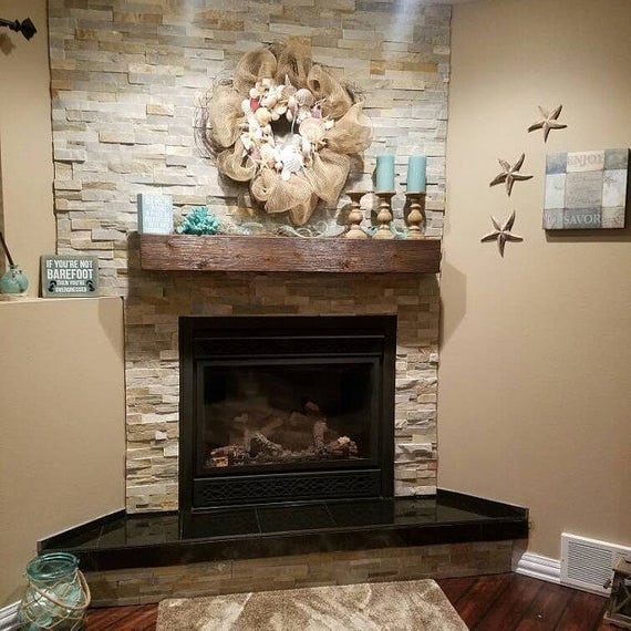 Wooden Fireplace Mantel.  Rugged wood finish fireplace mantle . Look of a solid beam. Made out of wood