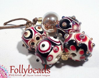 Handmade Lampwork Artisan glass bead set in Black, White and Red with gold dots