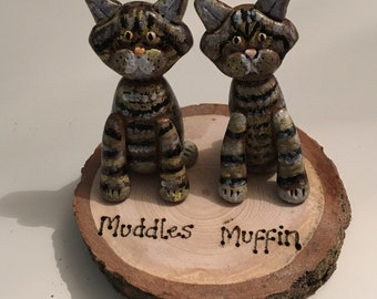 Lovely pet cariacatures on a wooden slice