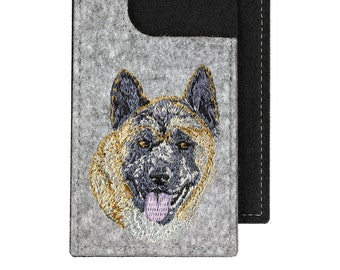 Akita Inu - A felt phone case with an embroidered image of a dog.