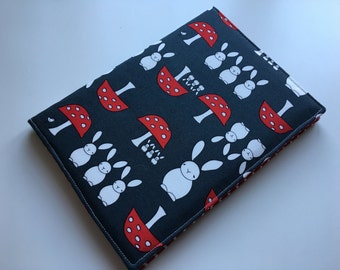 A5 covered notebook or diary. Grey bunny and toadstool fabric with red polka dot lining - perfect back to school gift