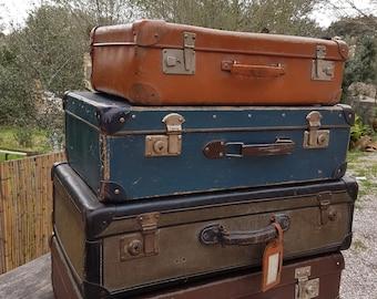4 vintage suitcases