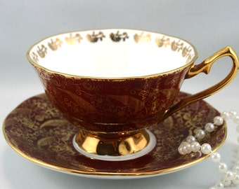 Very Elegant Elizabethan Footed Teacup & Saucer Sovereign Pattern, Nicely Gilded Burgundy Borders, Bone English China made in 1970s.