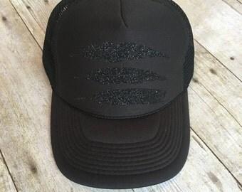 Adult black on black feather trucker hat