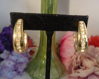 "25% off with Coupon Code 70417 Vintage Goldtone Screw Back 1.25"" Earrings that feature a Strip of Rhinestones in the center of the Earring."
